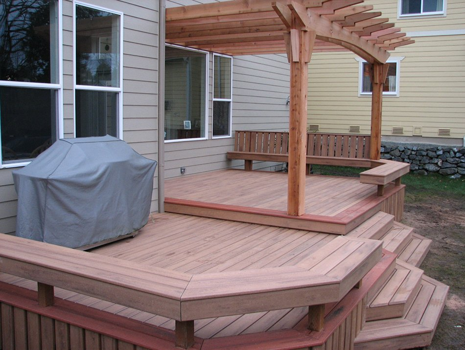 composite deck with a pergola in seattle by Master Decks, LLC