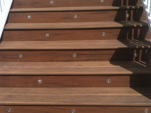 Composite decking with lit staircase by Master Decks, LLC