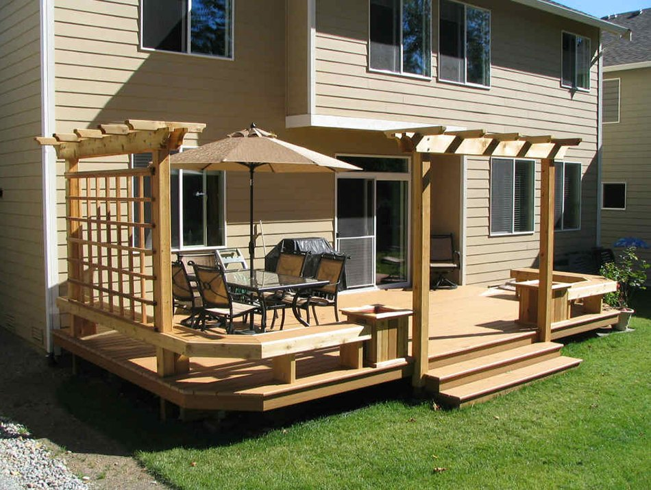 custom composite deck with a pergola in Seattle by Master Decks, LLC