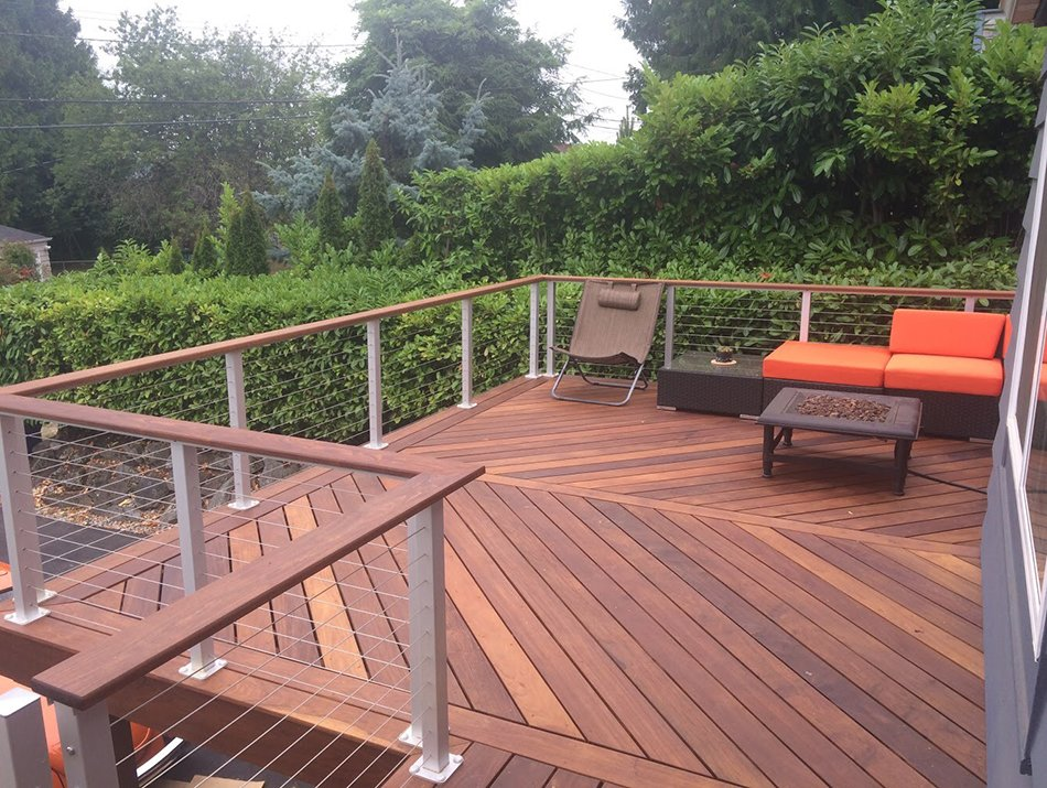hardwood decking with cable railing by Master Decks, LLC